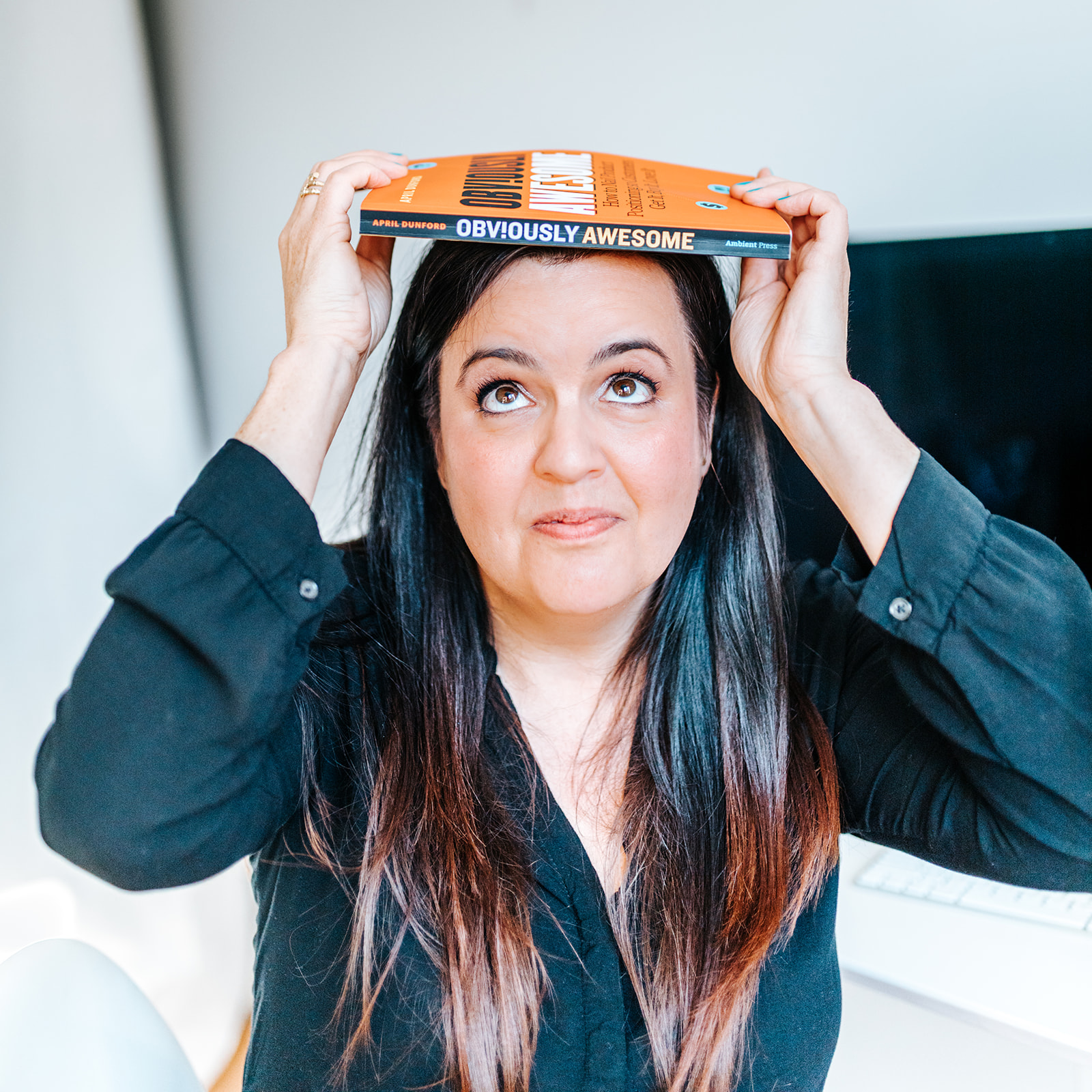 Genevieve Rochon with book on top of head